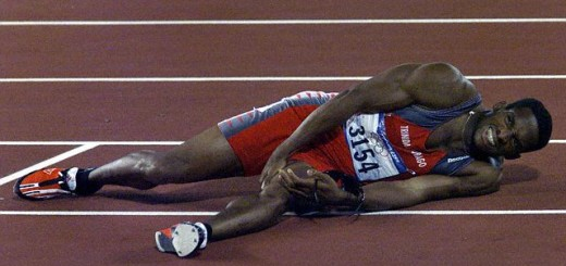Original caption: Trinidad's Ato Boldon holds his leg in pain after the 200m final at the Sydney Olympic Games, September 28, 2000. Greece's Konstantinos Kenteris won the race in a time of 20.09, Campbell was second with 20.14, Boldon was third with 20.20.         REUTERS/David Gray